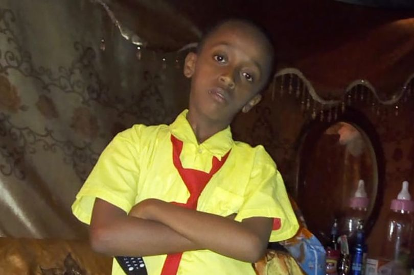13year-old boy shot dead by police on his balcony.